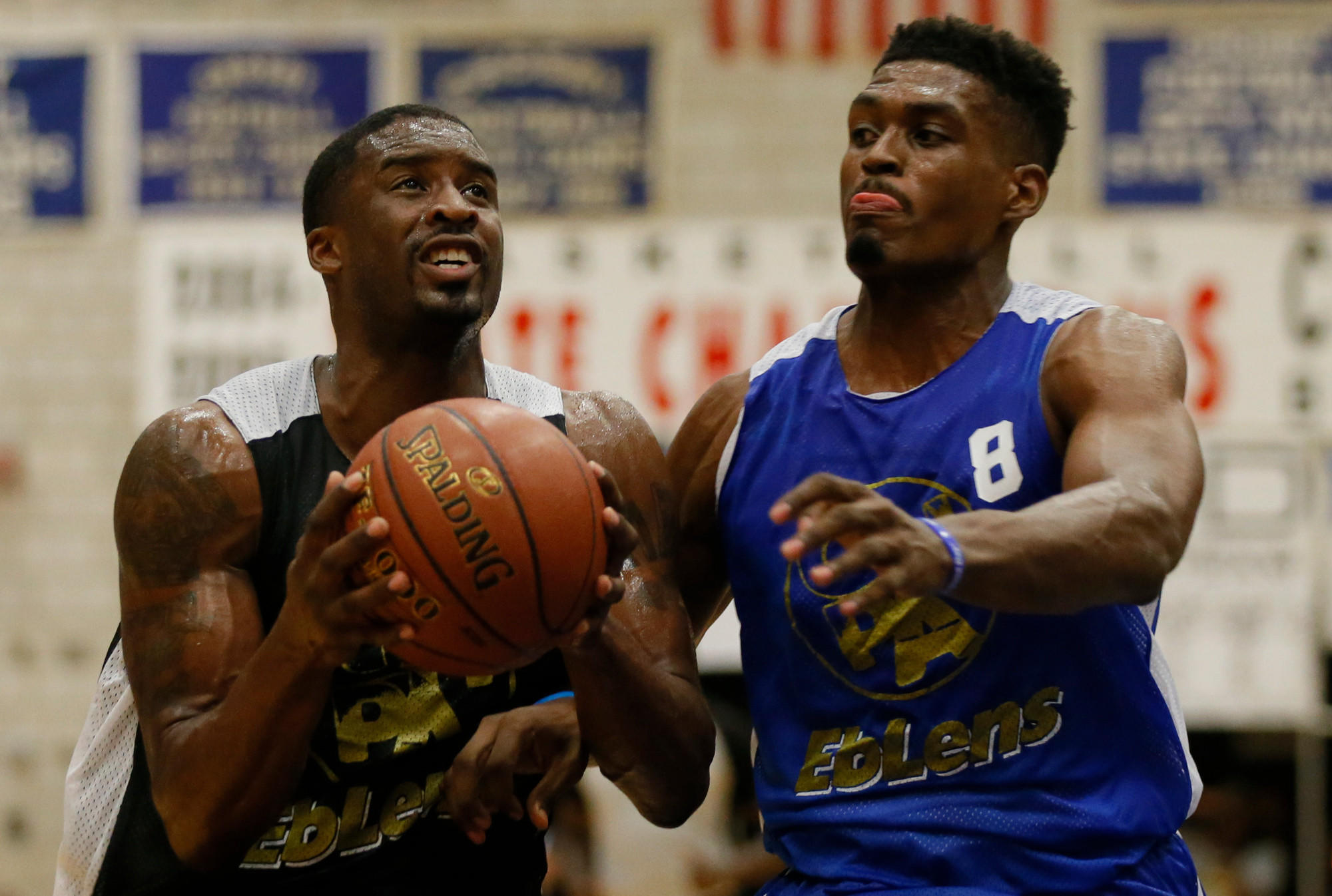 Waterbury, CT 07/09/14; NBA Portland Trail Blazers player Wesley Matthews drives the ball against Brandon Sherrod in the Greater Hartford Pro-Am Summer Basketball League opening night at Crosby High School. photo by David Butler II
