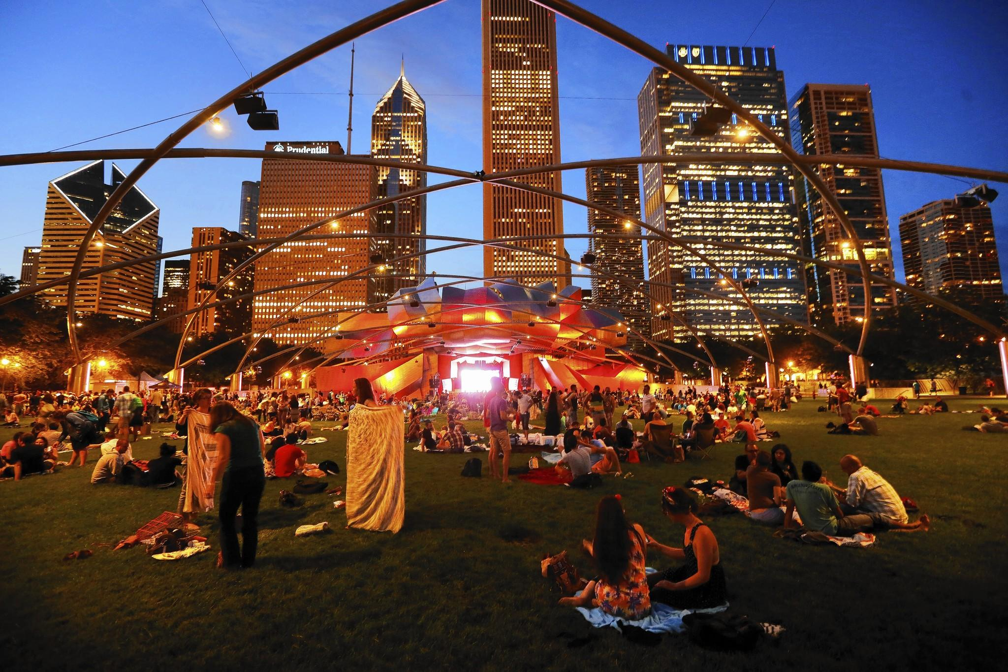Visitors pack up after a free concert in Millennium Park on June 2 featuring Robbie Fulks at the Pritzker Pavilion. The park is in its tenth year this summer.