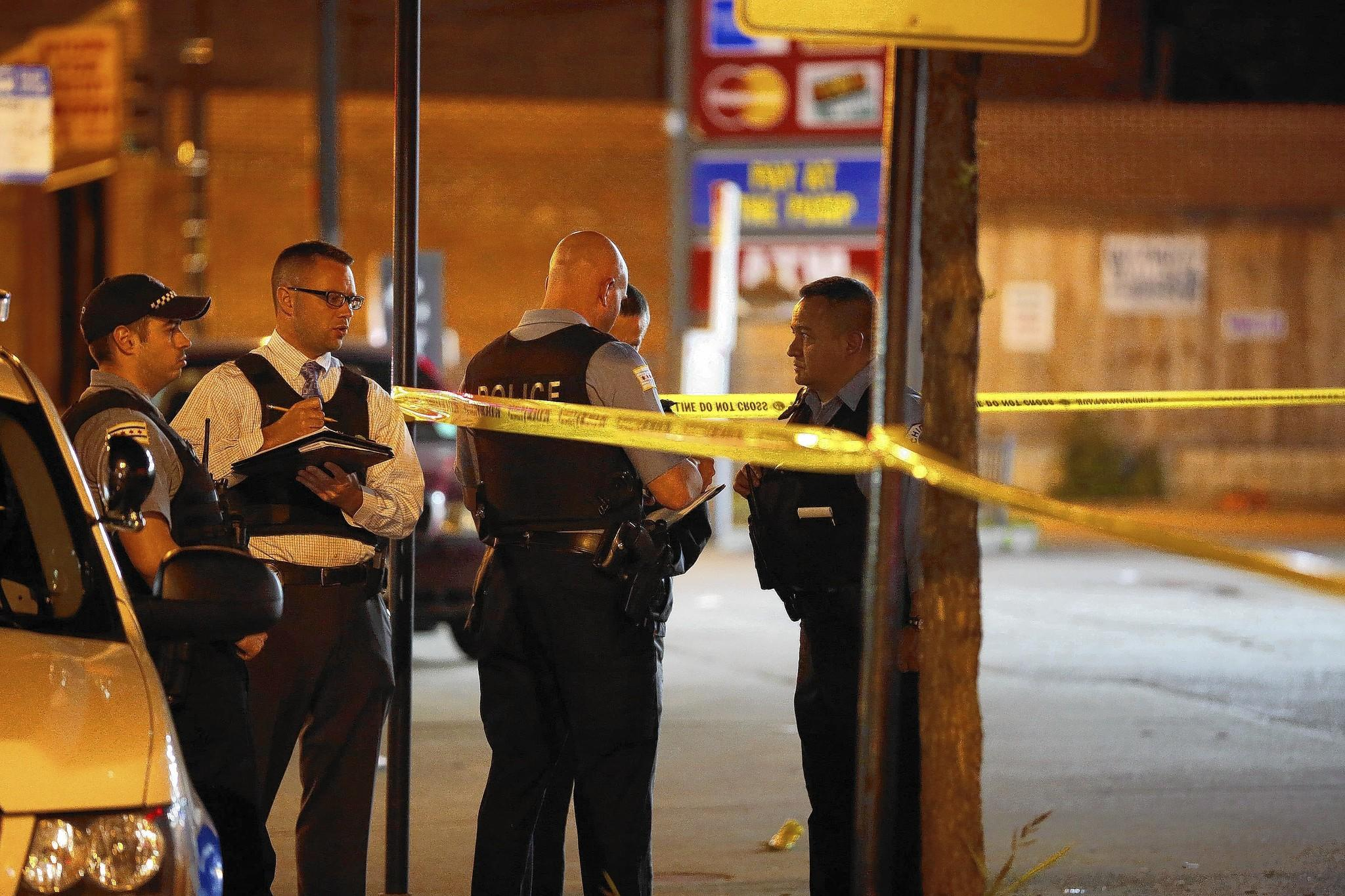 Chicago police at the scene of a shooting in July. Two people were shot, one fatally.