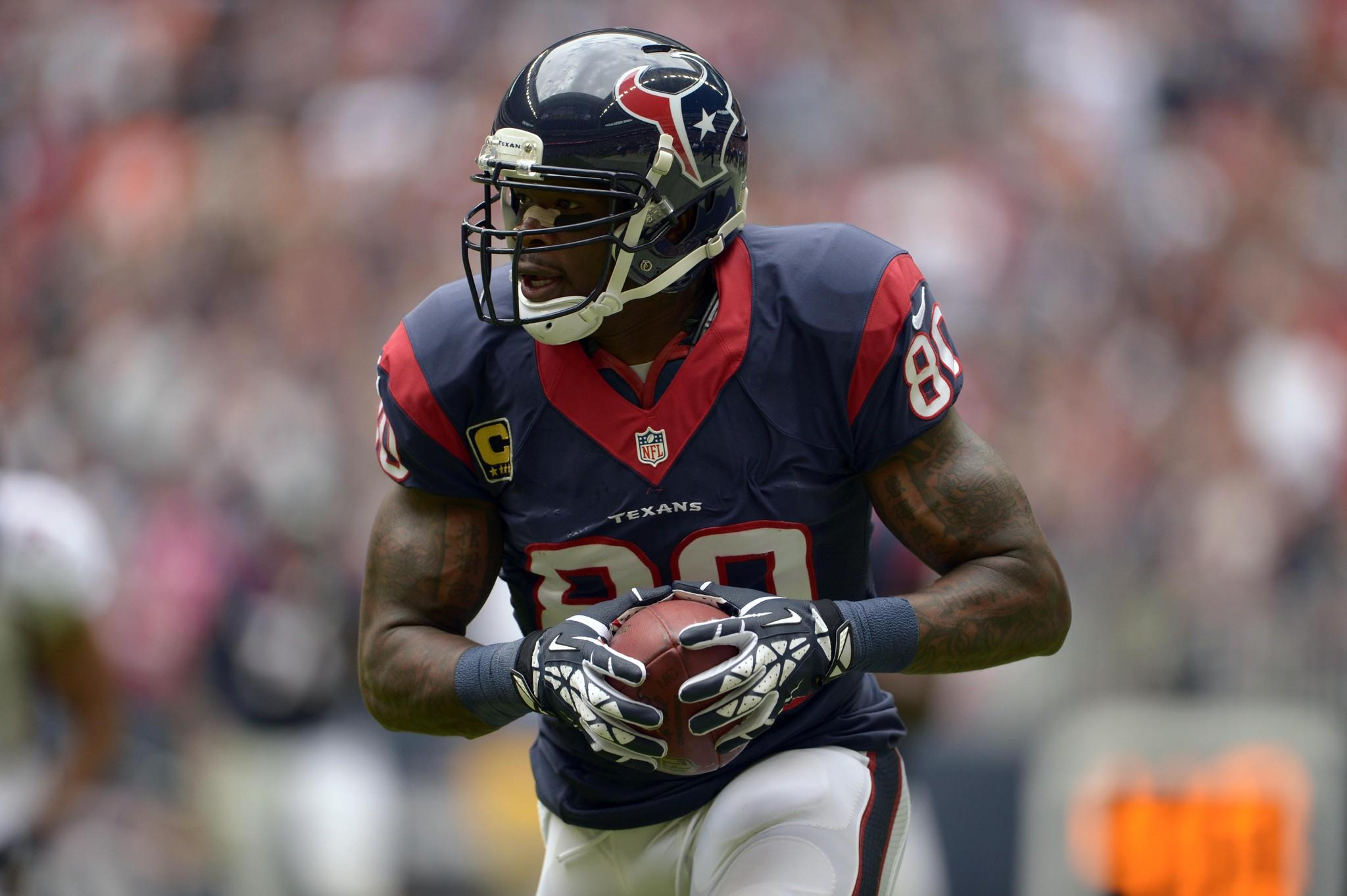 Houston Texans wide receiver Andre Johnson runs after a catch against the Denver Broncos last season.