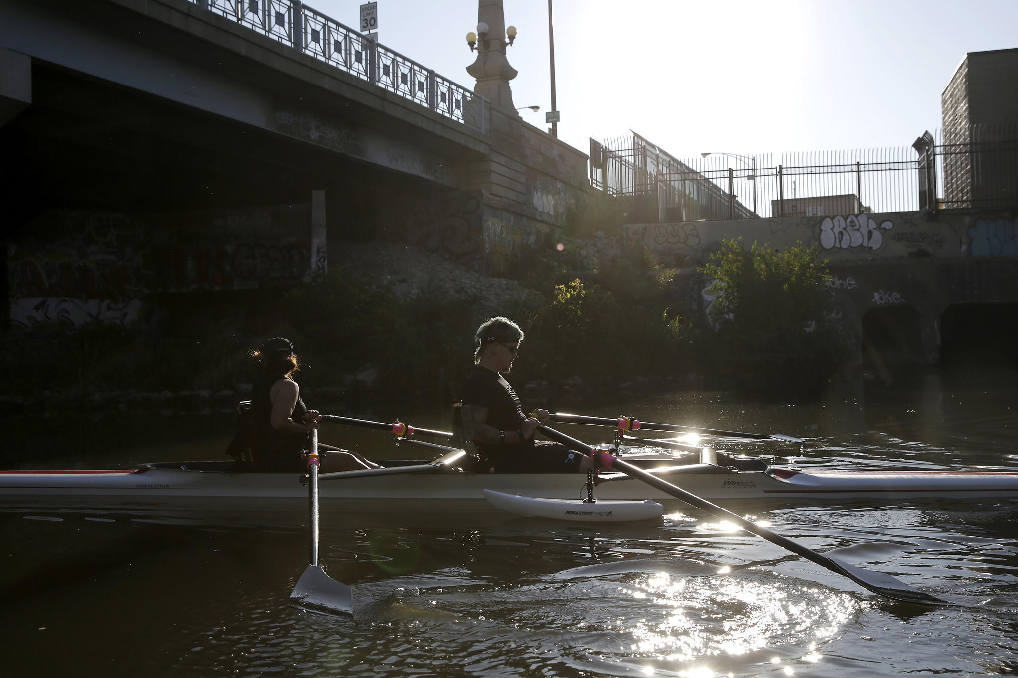 Injured veteran Ben Donovan, right, rows with Su Bermingham of the Chicago Rowing Foundation.
