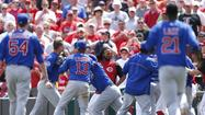 Cubs fight for 6-4 win over Reds