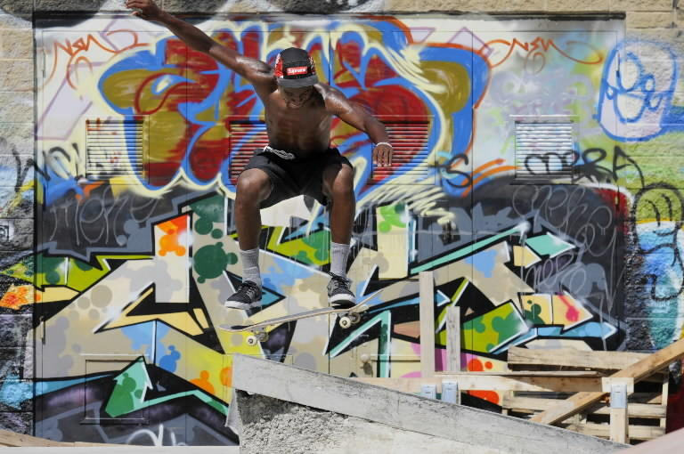 Among a frenzy of color and line Trevor Brown, 18, of Hartford tries out Hartford's Heaven Skate Park on Wednesday due to officially open at noon on Saturday.