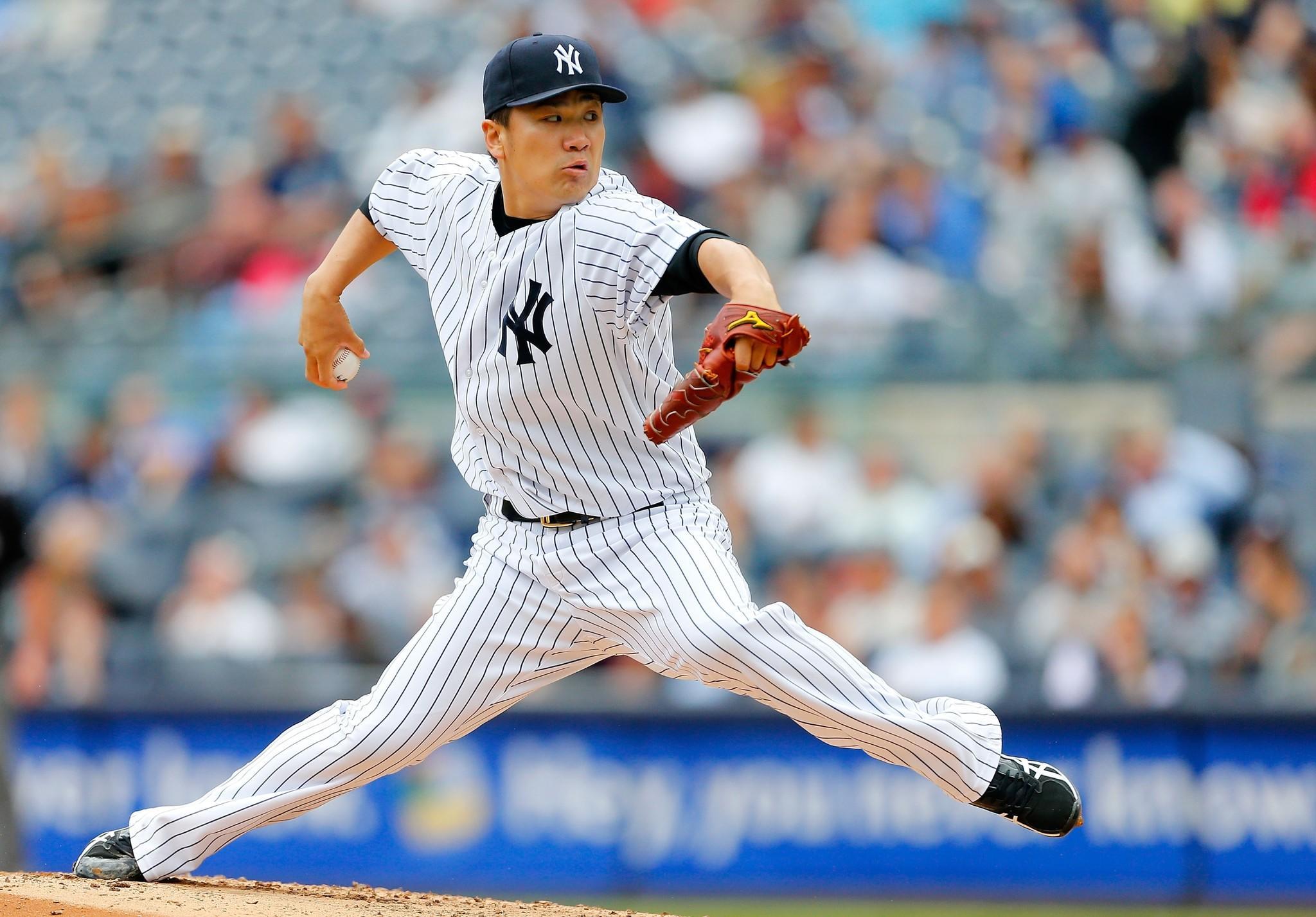 Yankees starter Masahiro Tanaka pitches in the third inning against the Athletics at Yankee Stadium on June 5.