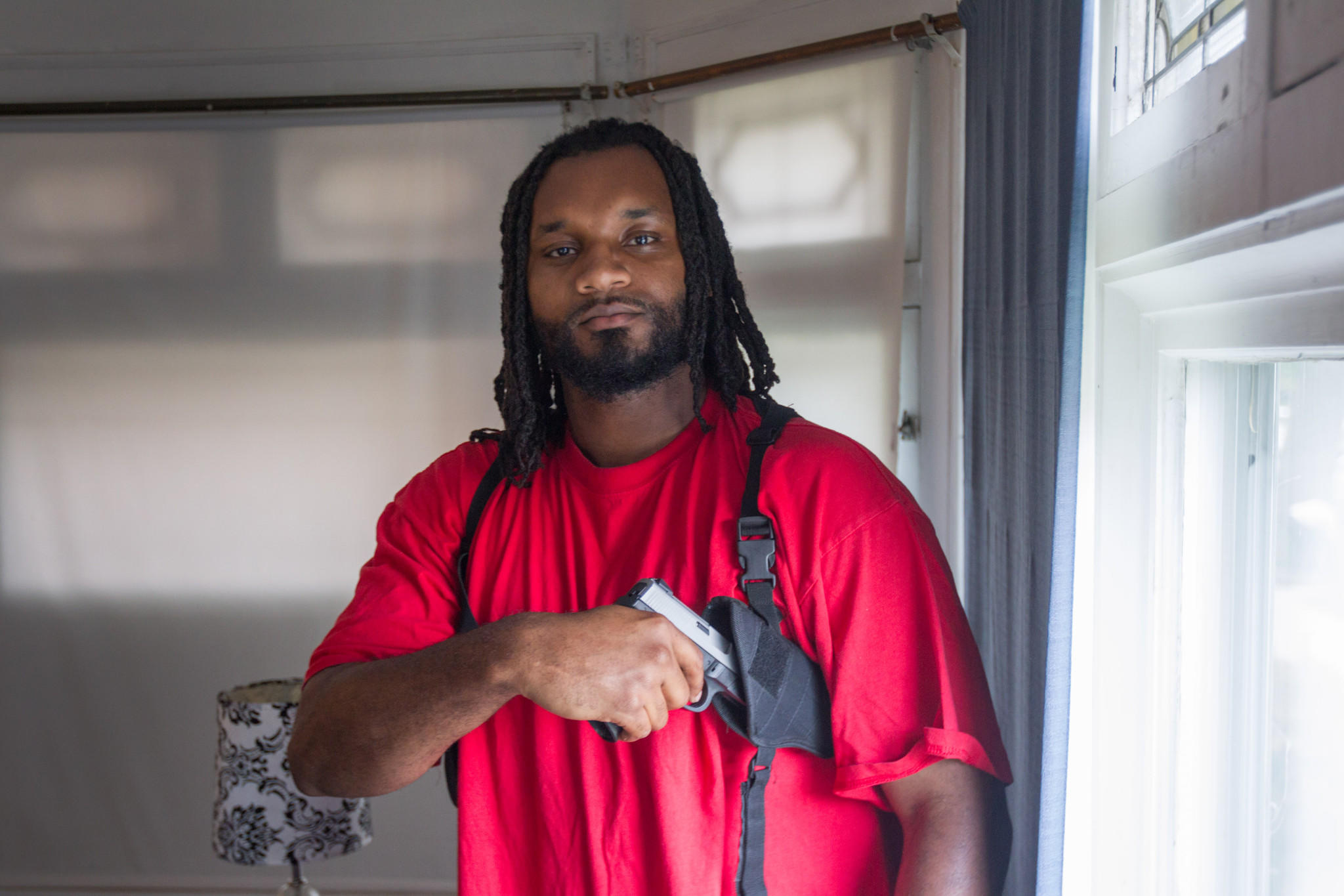 Michael Thomas with his gun at his home on the south side of Chicago, Tuesday, May 20, 2014. Michael Thomas has sued the Illinois State Police for denying his application for a concealed carry license without giving a reason why.