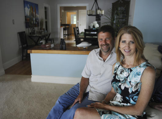 Wayne and Wende Allen sit in their dream vacation home, an Edgewood property only miles from their primary residence.