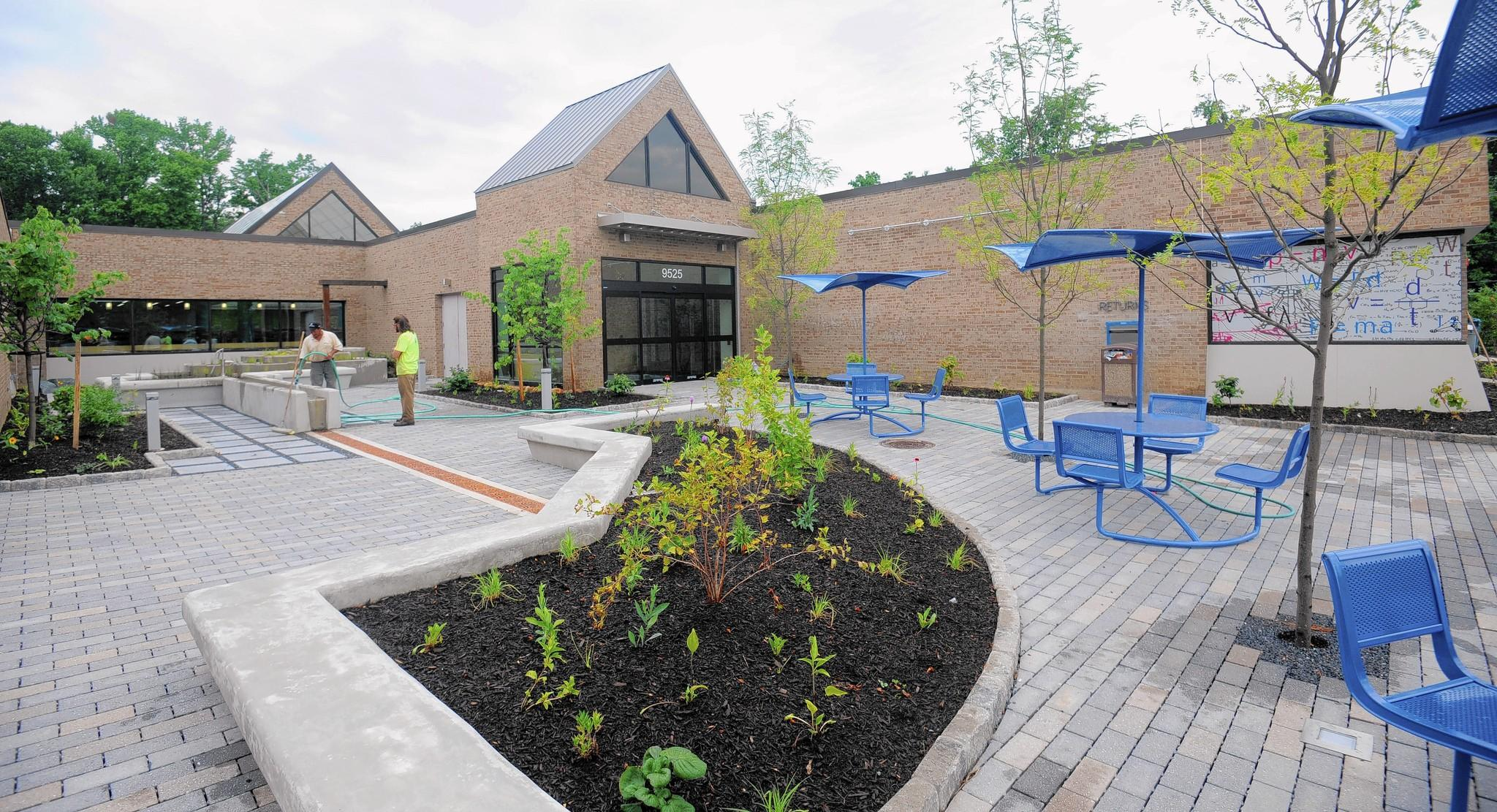 Native plants, a stormwater management system and seating in the courtyard of the renovated Howard County Library System (HCLS) Savage Branch and STEM Education Center. The branch will reopen July 22.