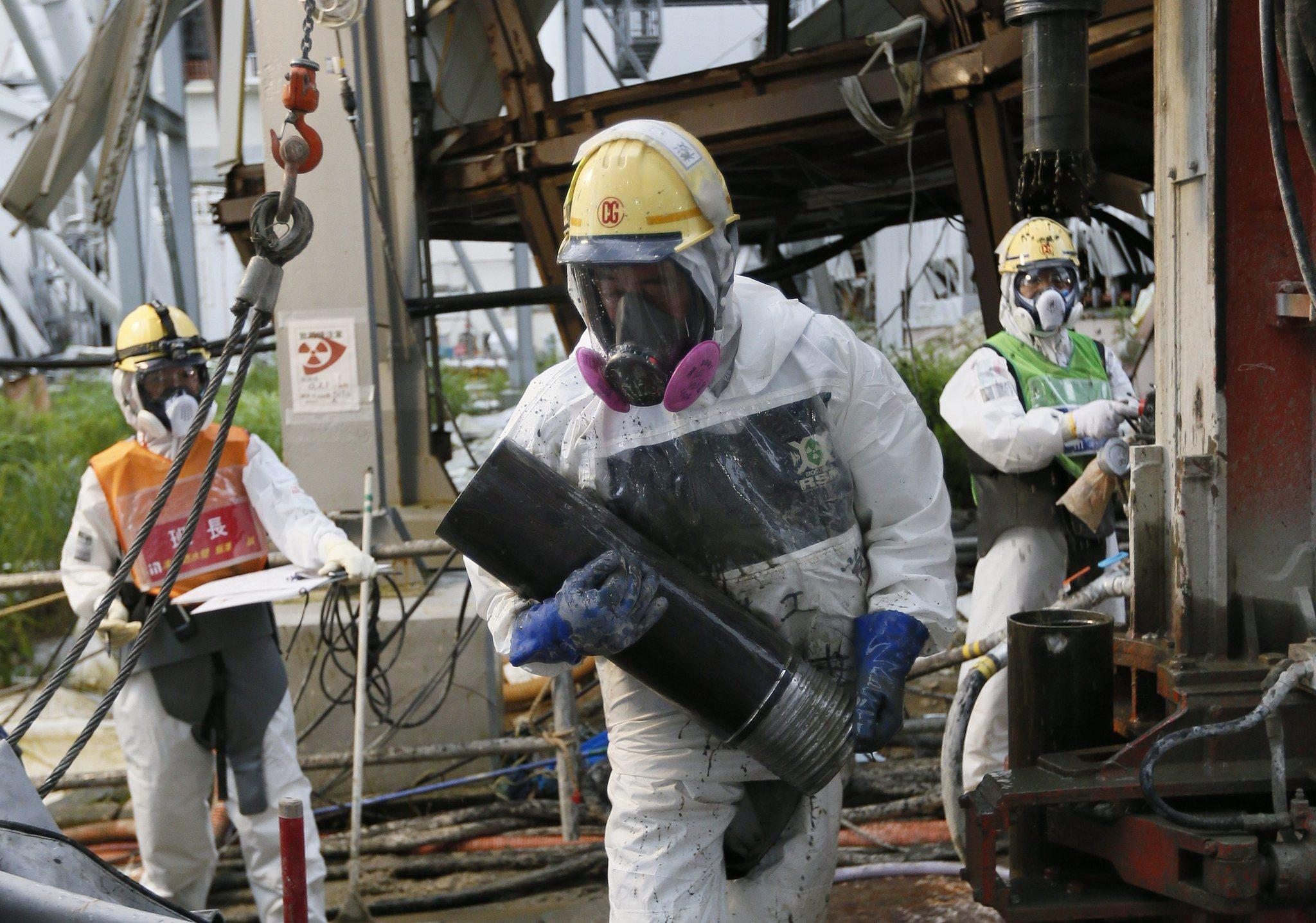 Workers construct ice wall to freeze highly toxic water at tsunami-crippled Tokyo Electric Power Co.'s Fukushima Daiichi Nuclear Power Plant in Okuma, Fukushima Prefecture, northeast of Tokyo, Japan.