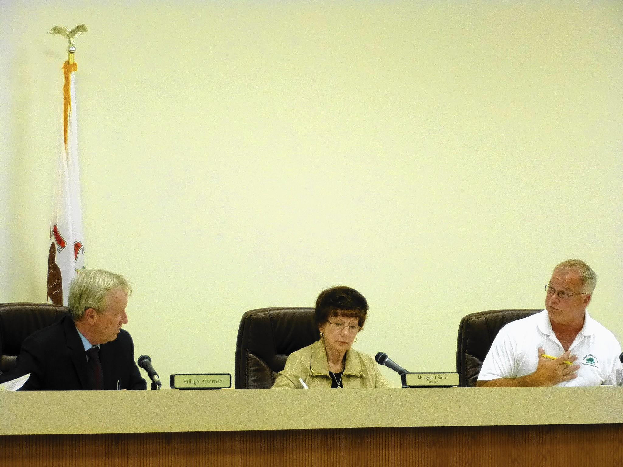 Village Attorney Mark Sterk, left, Trustee Margaret Sabo and Trustee George Yukich at the July 8 workshop.