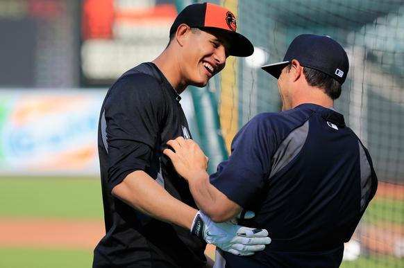 Manny Machado, left, of the Orioles talks with Brian Roberts of the New York Yankees before the start of the game at Oriole Park.