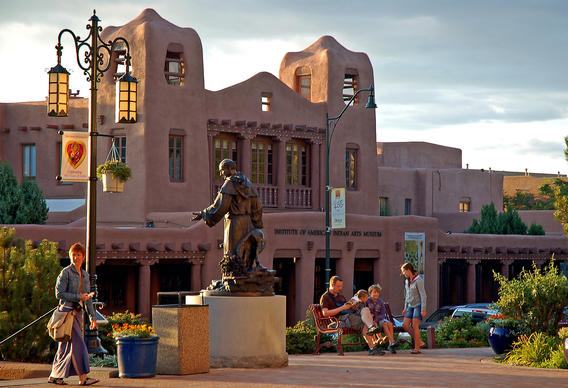 A statue of 19th century Archbishop Jean-Baptiste Lamy stands in downtown Santa Fe, across the street from the Institute of American Indian Arts Museum.