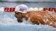 Phelps comeback marches on with butterfly win