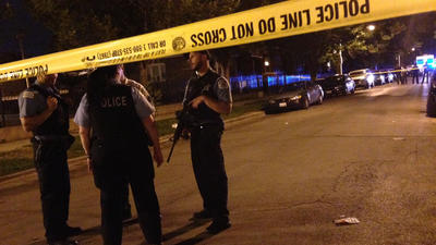 At least 1 dead, 13 wounded in city shootings