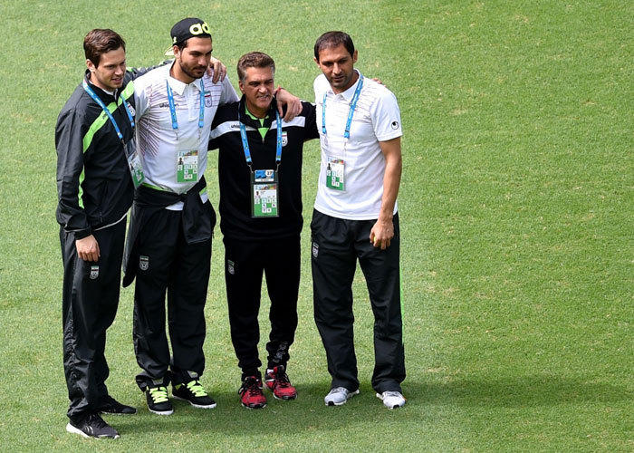 Goalkeepers coach Dan Gaspar, second from right, with Iran's goalkeepers, from left, Daniel Davari, Alireza Haghighi and Rahman Ahmadi as their team visits at the Fonte Nova Arena in Salvador on June 24, 2014, on the eve of their 2014 FIFA World Cup Group F match against Bosnia-Hercegovina.