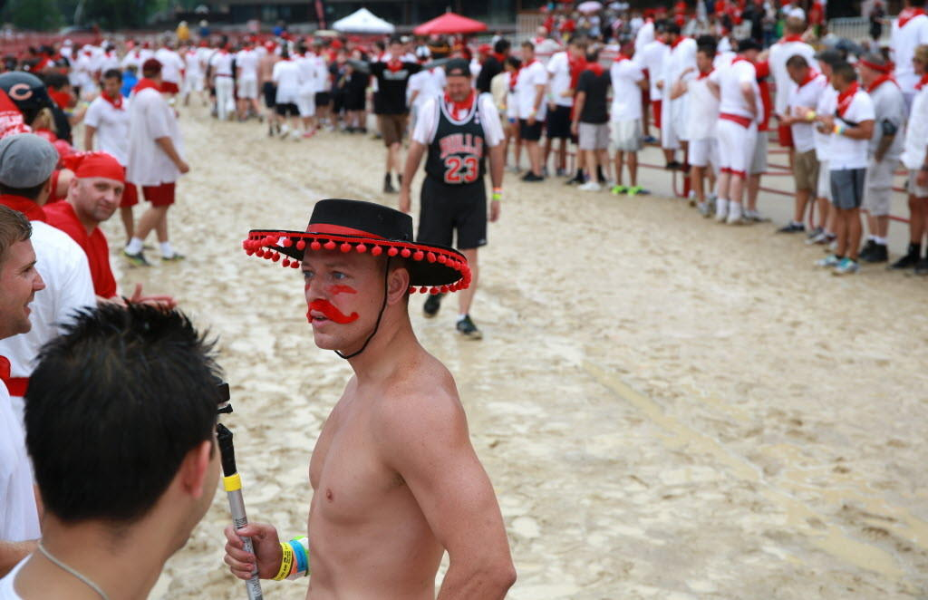 A man wearing a matador hat waits for the start of The Great Bull Run at Hawthorne Race Course, 3501 S. Laramie Ave., Saturday, July 12, 2014, in Chicago.