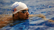 Phelps wins 100m backstroke as comeback continues