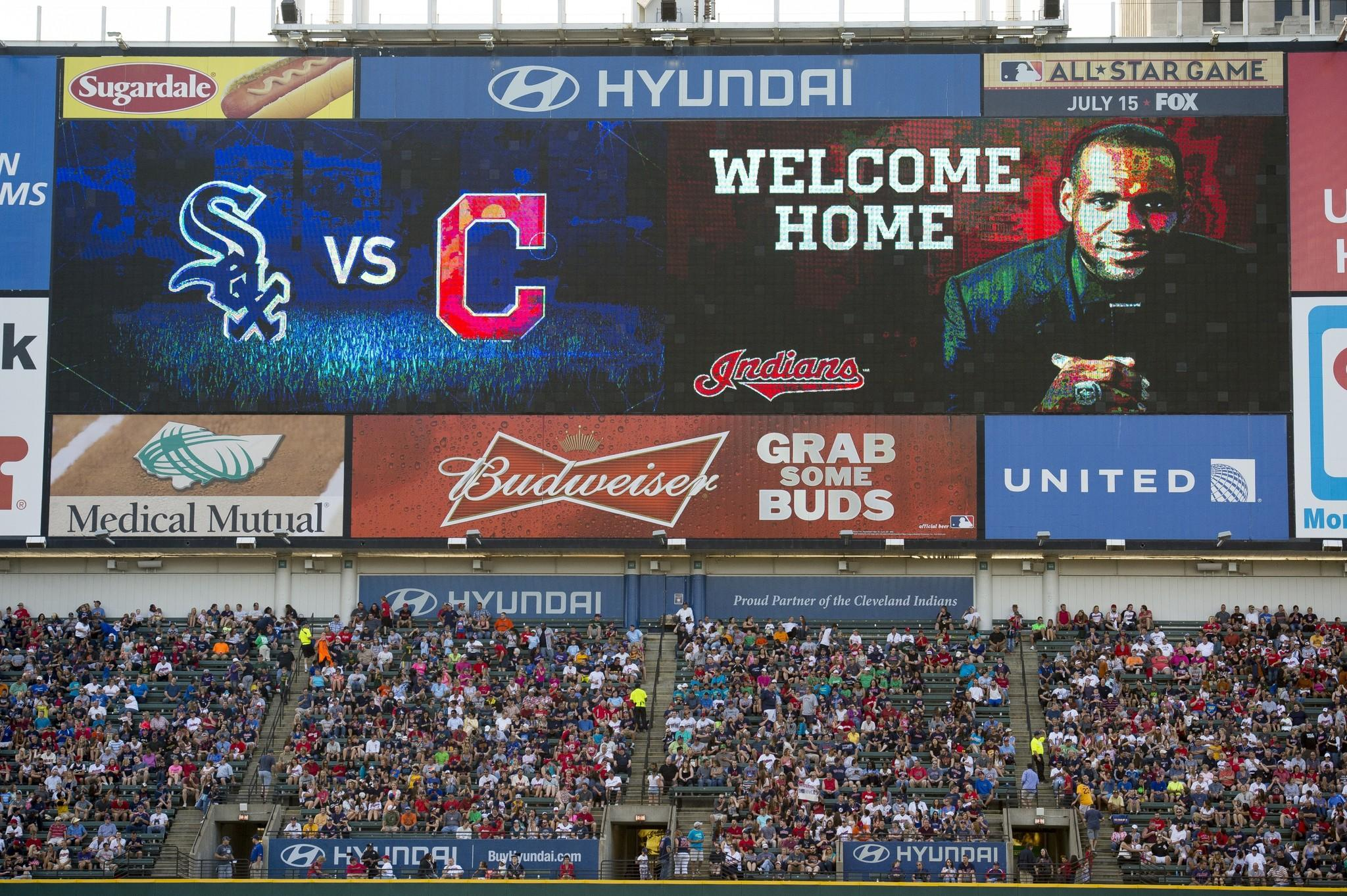 The Cleveland Indians show their support for LeBron James with a welcome home message on the scoreboard.