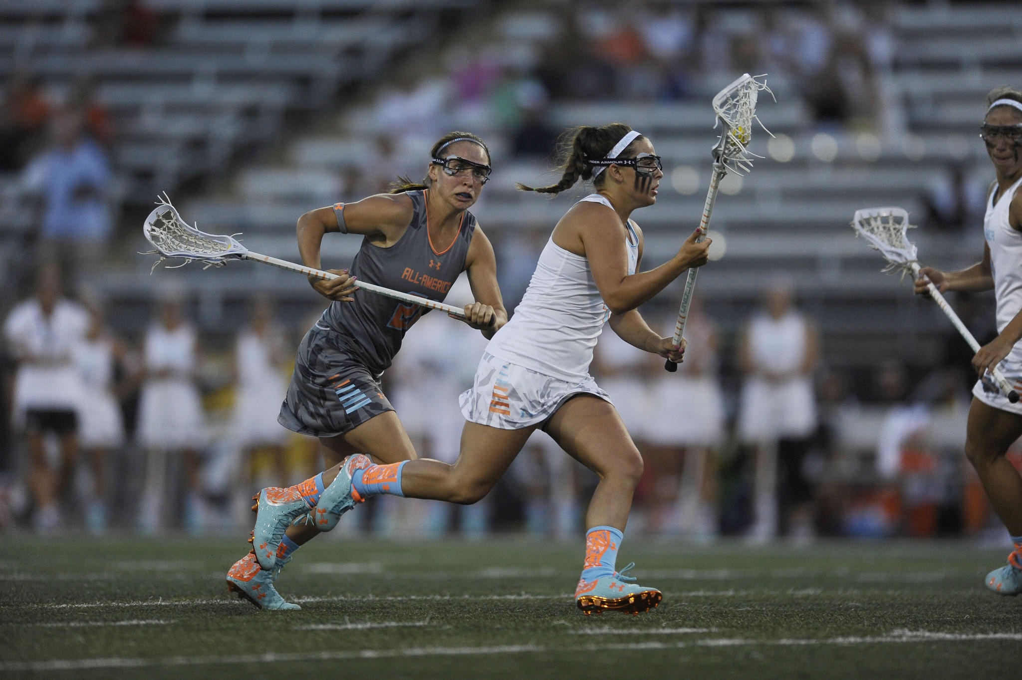 Selena Lasota chases South #4 Taylor Hensh in the 2014 Under Armour All-America Lacrosse Classic.