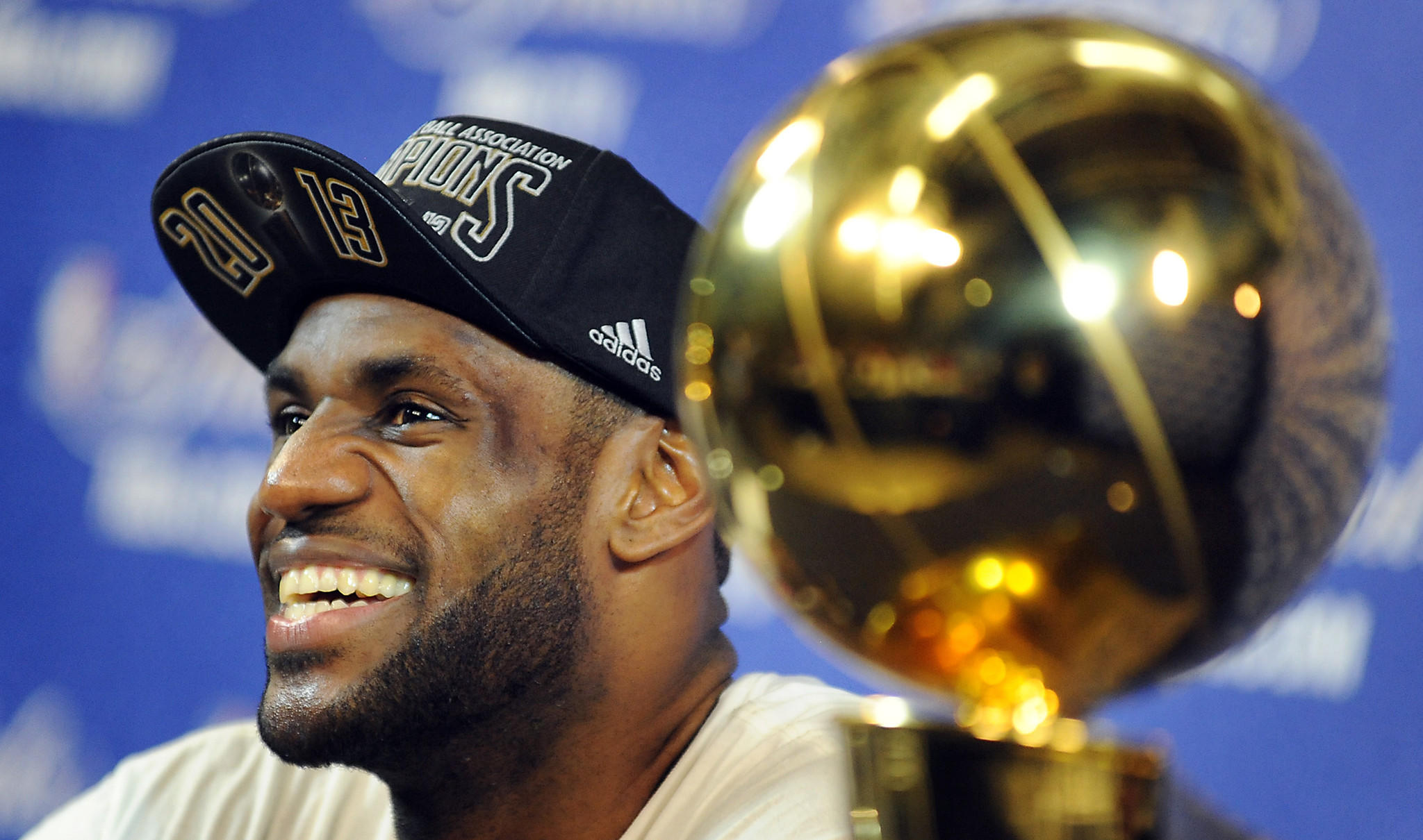 LeBron James smiles big during his post game press conference.