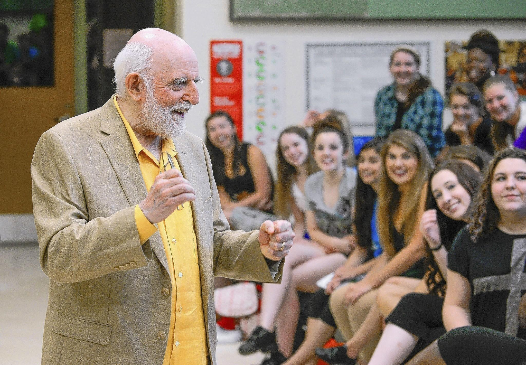 "John Astin, who played Gomez in the 1960's TV show, ""The Addams Family,"" speaks to students, offering a rare treat to kick off their summer theater camp Monday morning at Glenelg High School where they will perform the Broadway play of the same name"