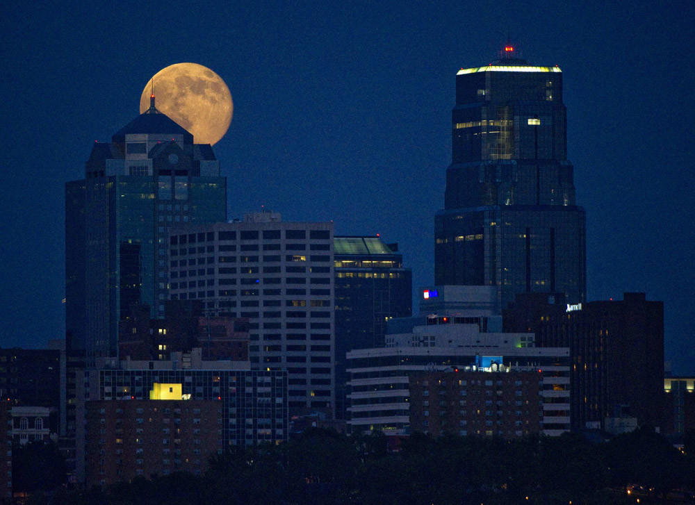 The Supermoon rises over downtown Kansas City, Mo., on July 12.