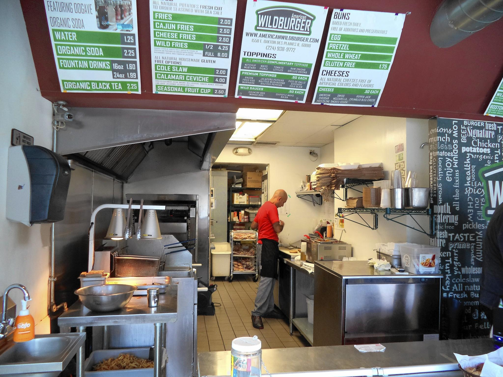 Alfredo Esparza, co-owner of American Wildburger, works in the restaurant's kitchen located at 1550 E. Oakton St. in Des Plaines.