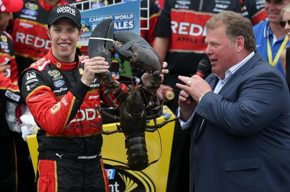 Brad Keselowski, driver of the #2 Redds Ford, celebrates in victory lane with a lobster after winning the NASCAR Sprint Cup Series Camping World RV Sales 301 at New Hampshire Motor Speedway on July 13, 2014 in Loudon, New Hampshire.
