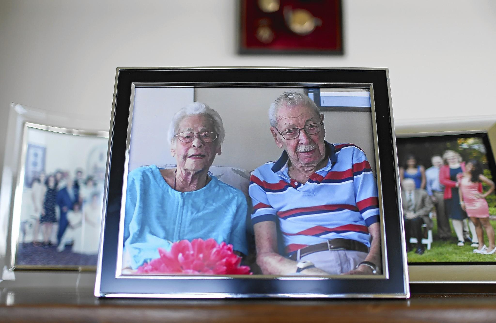 A family photo of Carlyn and Irv Ungar is displayed in their Lakeview home. Carlyn, 100, died earlier this month. Irv, also 100, survives.