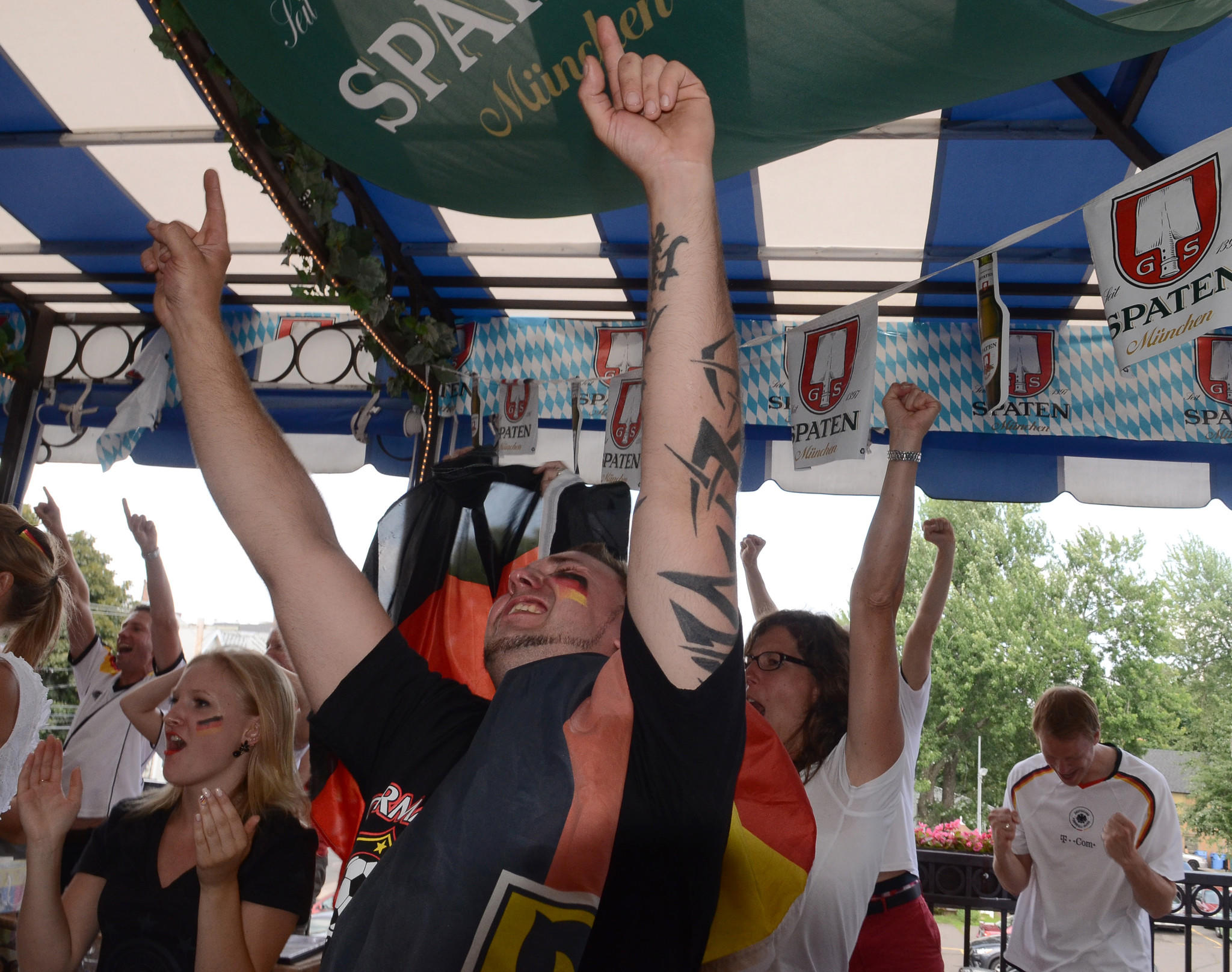 Steve Koegler of New Britain celebrates at the German Restaurant in New Britain after Germany scored a goal in extra time in the World Cup final in Brazil Sunday afternoon. Germany beat Argentina 1-0 in Rio de Janeiro to win the tournament.