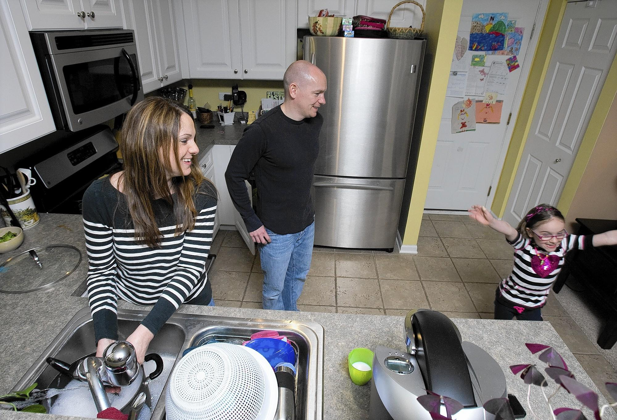 Scott and Caroline Schmauderer, with daughter Haley, hoped to move out of their town house in Lake in the Hills after their family grew, but they are underwater on their mortgage and don't qualify for a loan modification.
