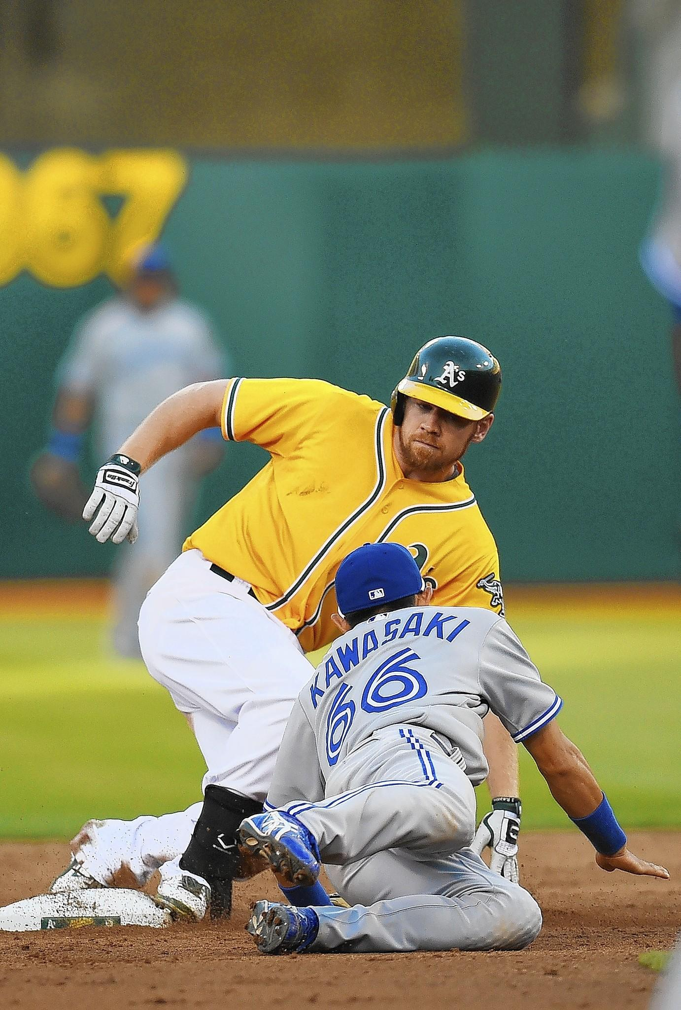 Brandon Moss of Oakland slides into second with a double against Toronto earlier this month.