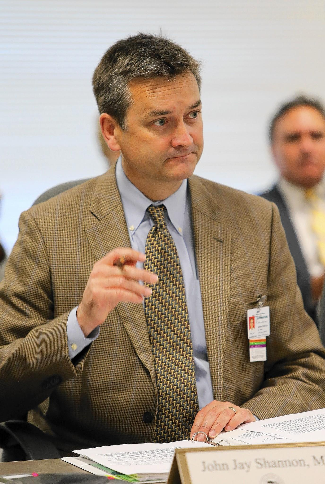 Dr. John Jay Shannon, head of the Cook County health system, has much to prove.
