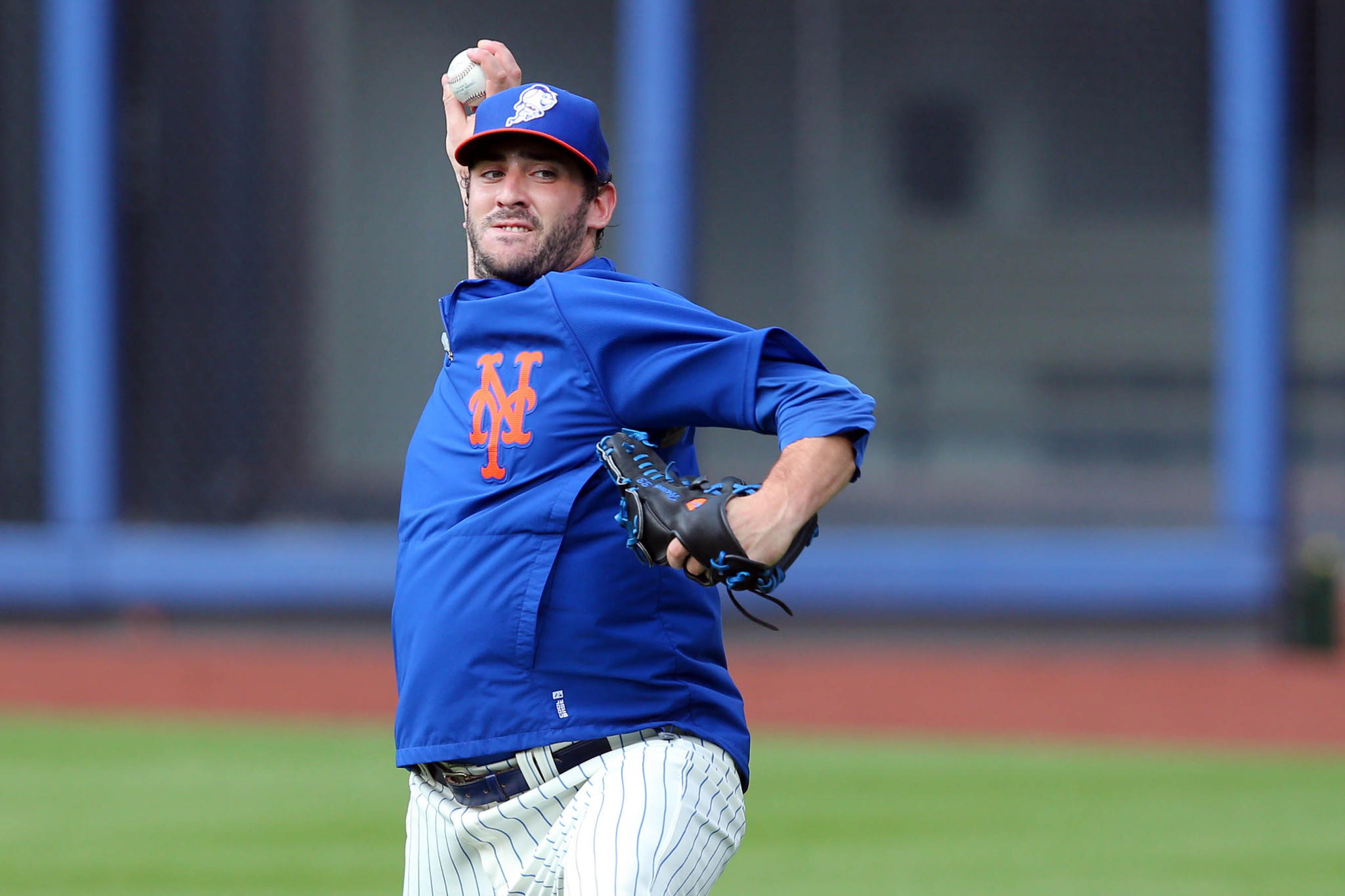 Jun 25, 2014; New York, NY, USA; New York Mets injured starting pitcher Matt Harvey (33) throws a session in the outfield before a game against the Oakland Athletics at Citi Field. Mandatory Credit: Brad Penner-USA TODAY Sports ORG XMIT: USATSI-167644