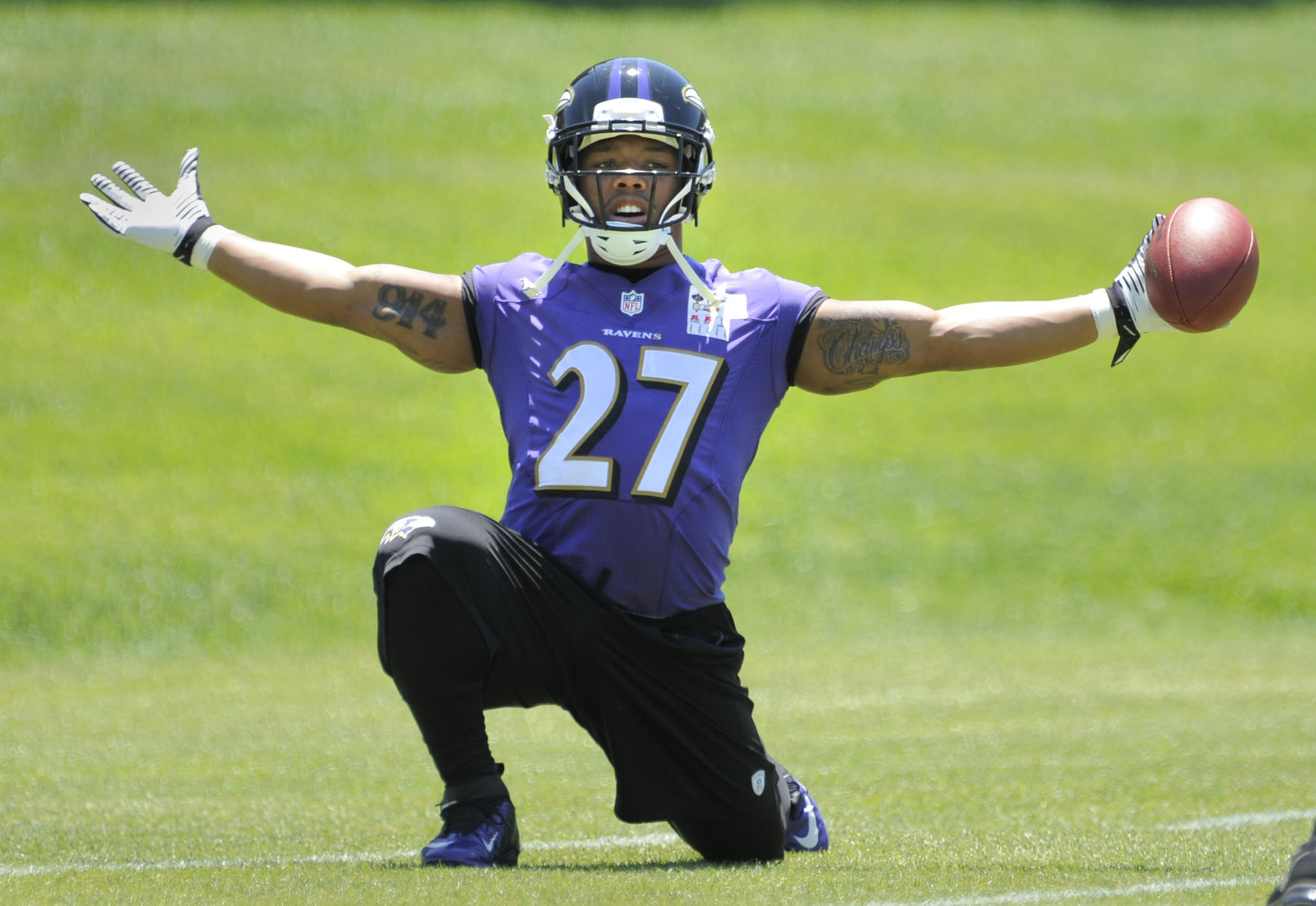 Ray Rice stretches before minicamp practice in June.
