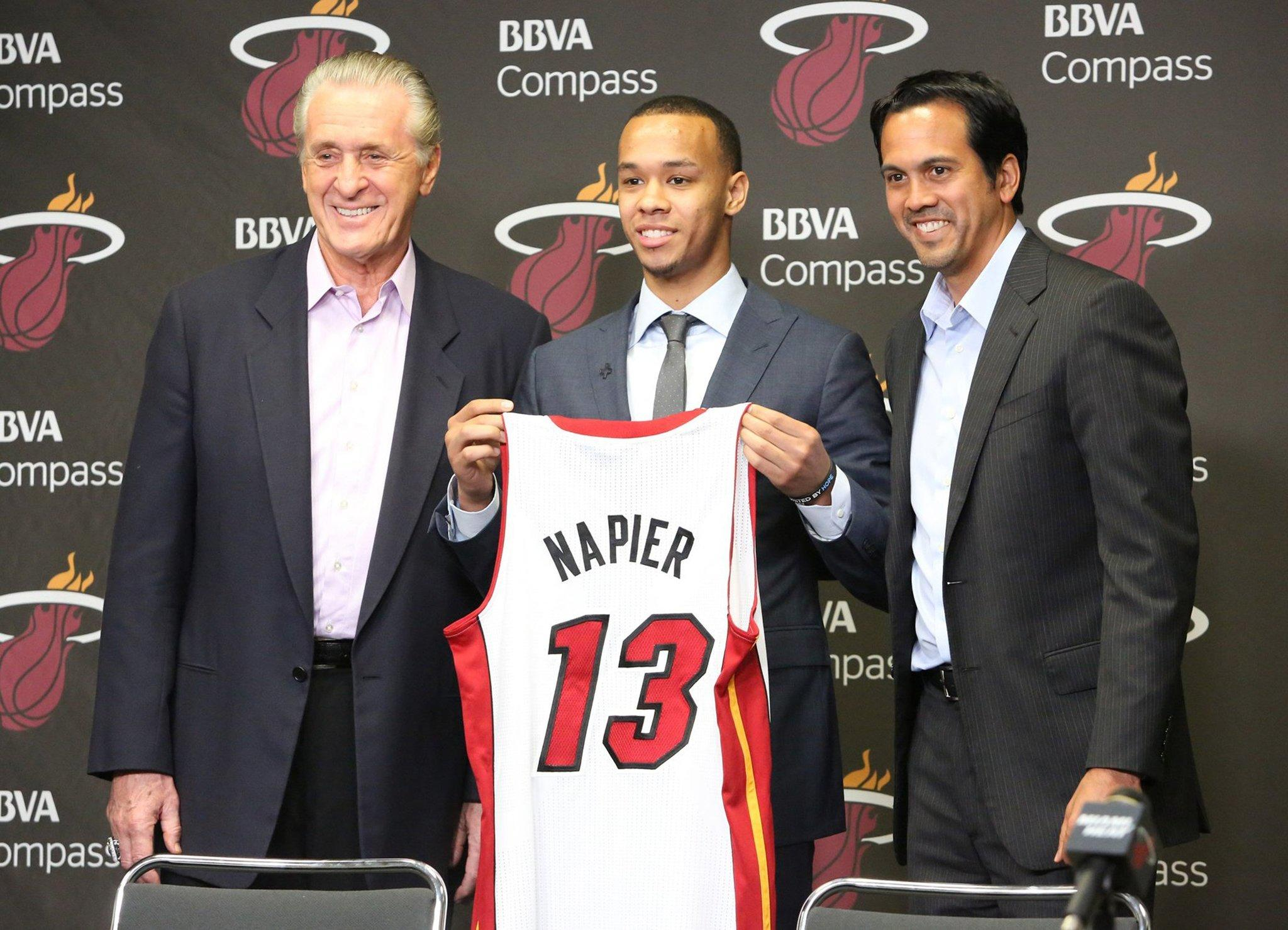 Miami Heat president Pat Riley, left, and Heat head coach Erik Spoelstra, right, pose for a photo with Shabazz Napier, the newest member of the team, at the AmericanAirlines Arena in Miami on Monday, June 30, 2014. (Hector Gabino/El Nuevo Herald/MCT)