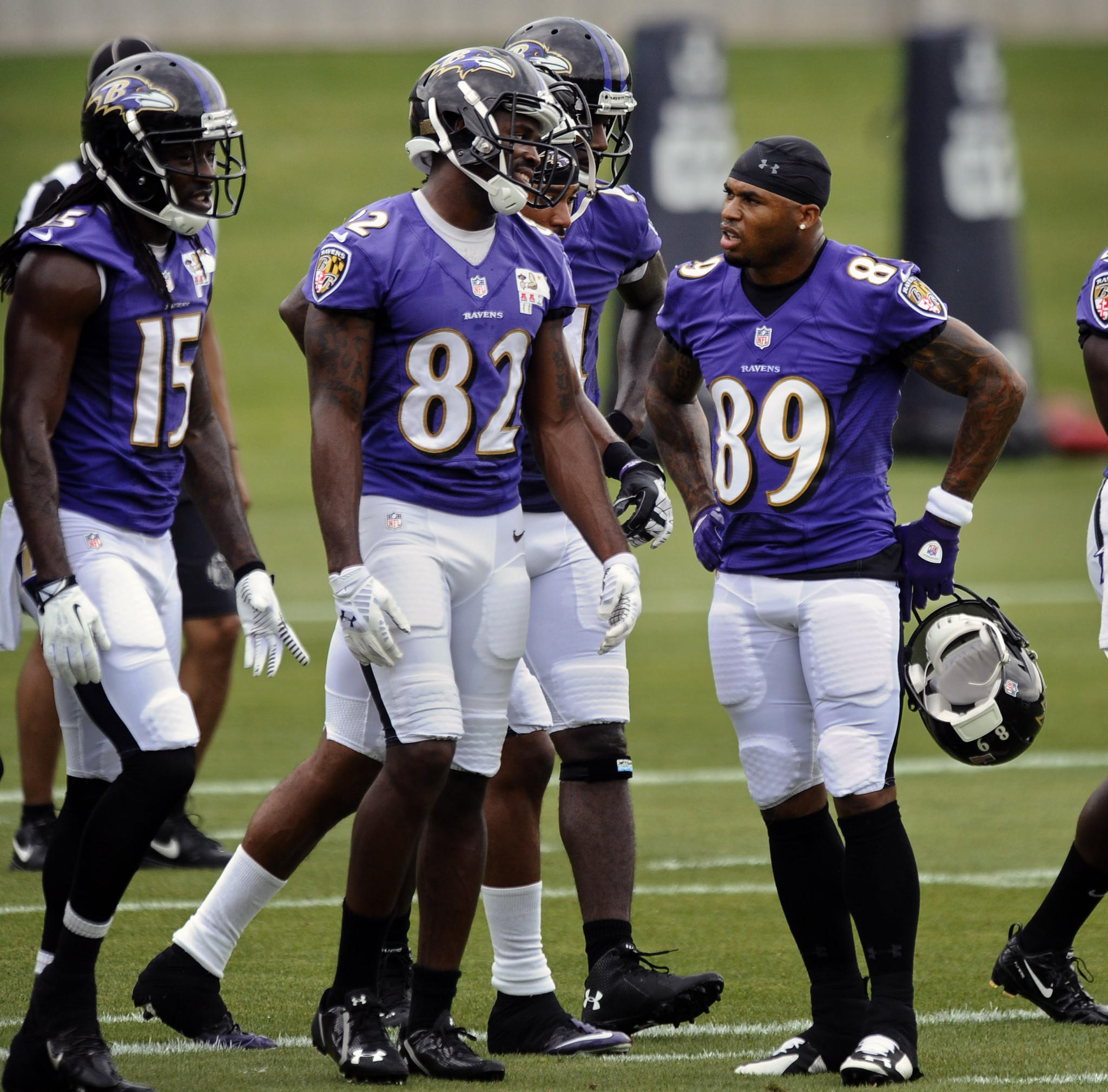 Ravens wide receiver Steve Smith (No. 89) interacts with teammate Torrey Smith on the last day of minicamp in June.