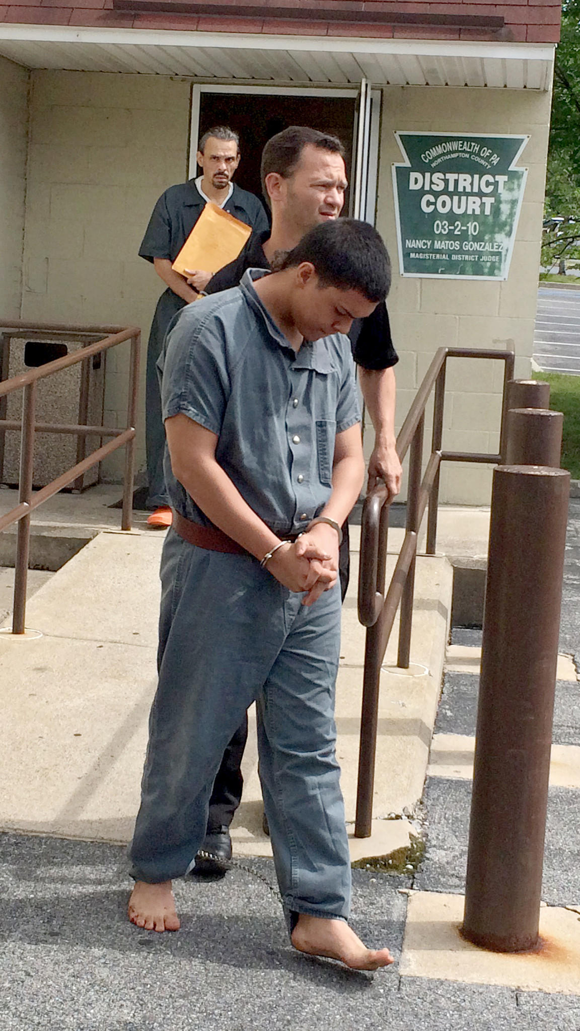 Bryan Sanchez-Ozorio (right) is escorted from his arraignment at district court in south Bethlehem on Wednesday. Sanchez-Ozorio is charged with attempted homicide and attempted rape in the strangling of a Lehigh University student in her off-campus apartment early Wednesday morning.