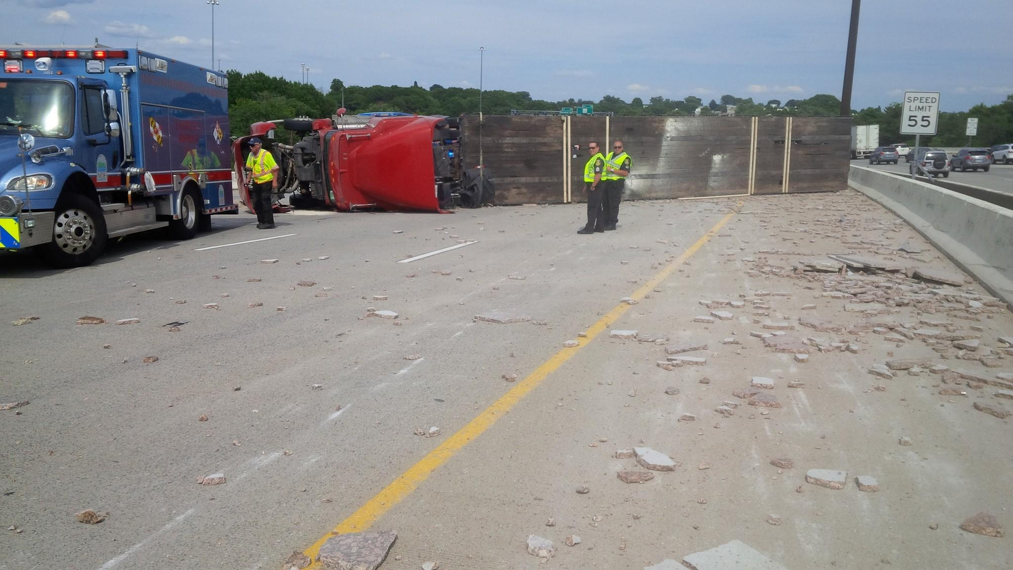 A tractor trailer overturned on Interstate 95 Wednesday afternoon, closing lanes for all southbound traffic just north of the Fort McHenry toll plaza.