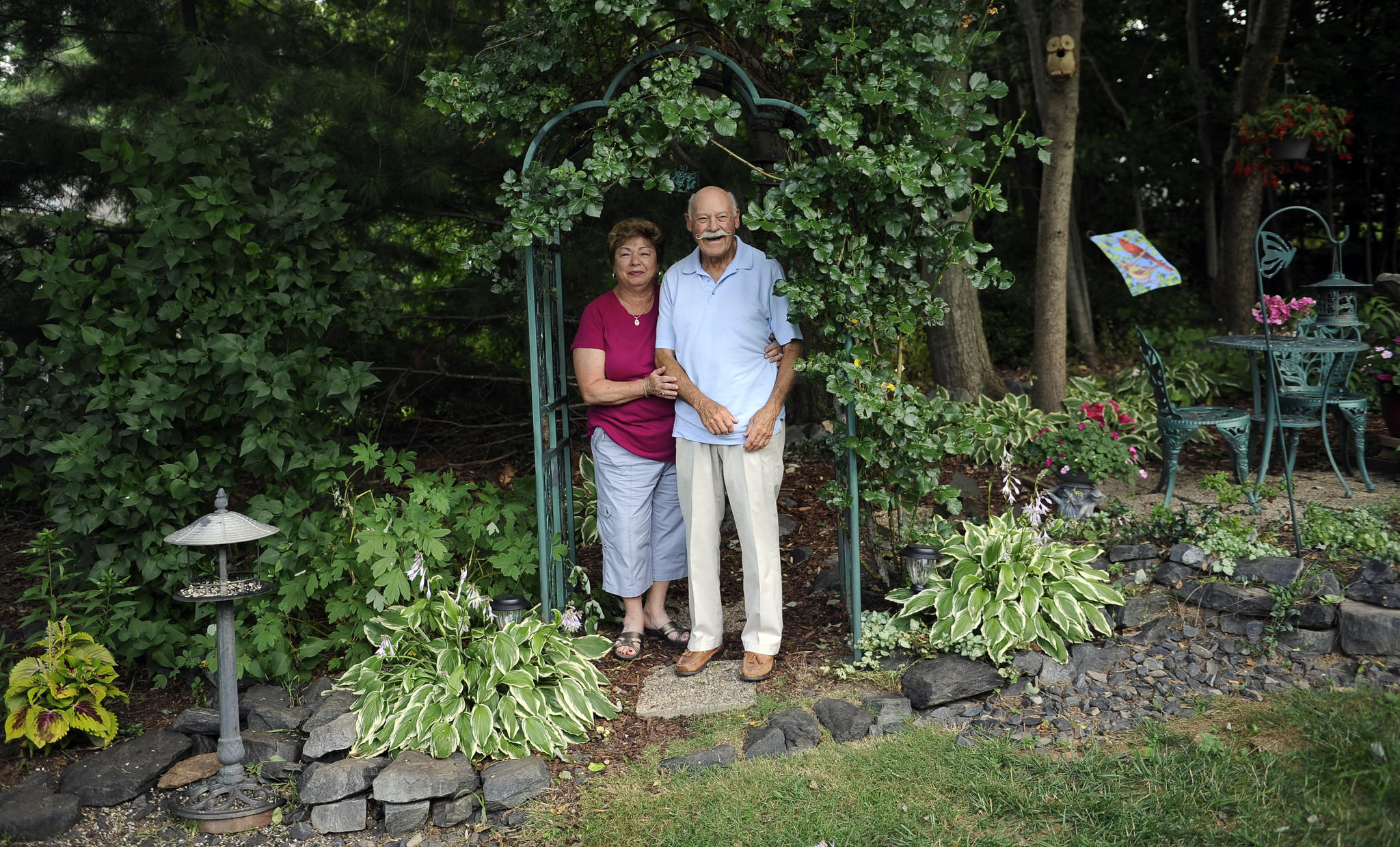 While not large, the Staylors' garden features an impressive variety of plants, including honeysuckle, peonies, weigela, crape myrtle, inkberry, wood poppy, vinca, lilac, hardy begonia, and an unusual double-blossom oakleaf hydrangea.
