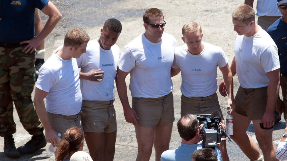 "Bradley Cooper, center, with cast and crew on the set of ""American Sniper"" in Malibu on June 4."