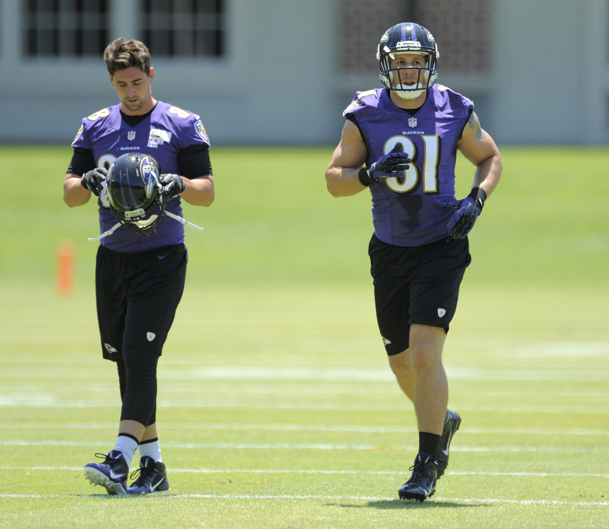 Tight ends Dennis Pitta and Owen Daniels during practice in June.