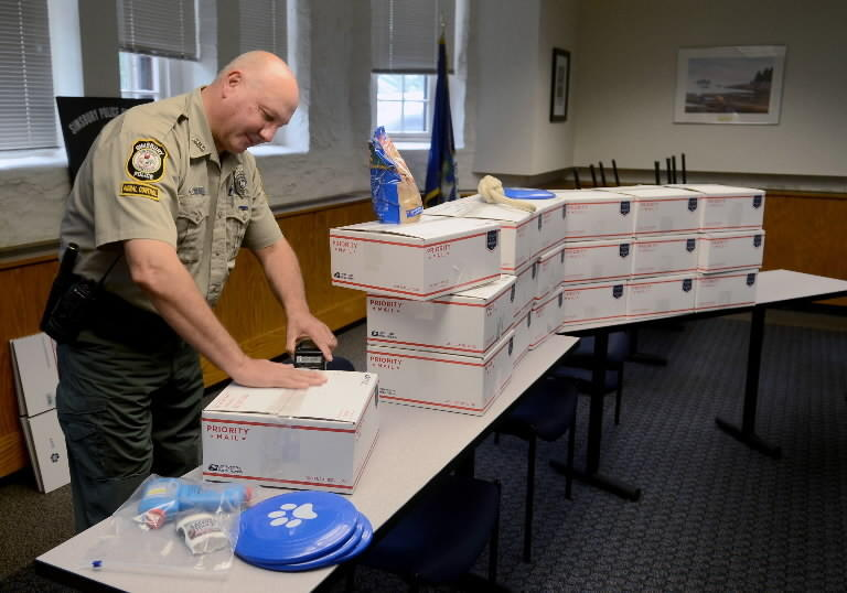 Mark Rudewicz, Simsbury's animal control officer, packs care packages at the Simsbury Police station, to send to the U.S. military who are stationed overseas. Officer Rudewicz launched the Heroes and Hounds program for military dogs and soldiers.