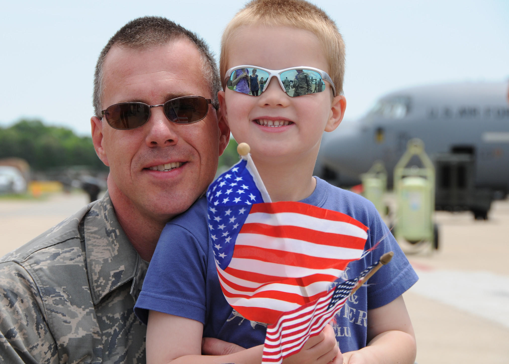 U.S. Air Force Tech Sgt. John Jones of the Maryland Air National Guard's 135th Maintenance Squadron, hugs his son, Nathan on the flight line on Warfield Air National Guard Base, Baltimore, Md., May 15, 2010. Sgt. Jones, a C-130 maintainer, and the 135th supported forces fighting in Afghanistan through transport supplies and cargo.