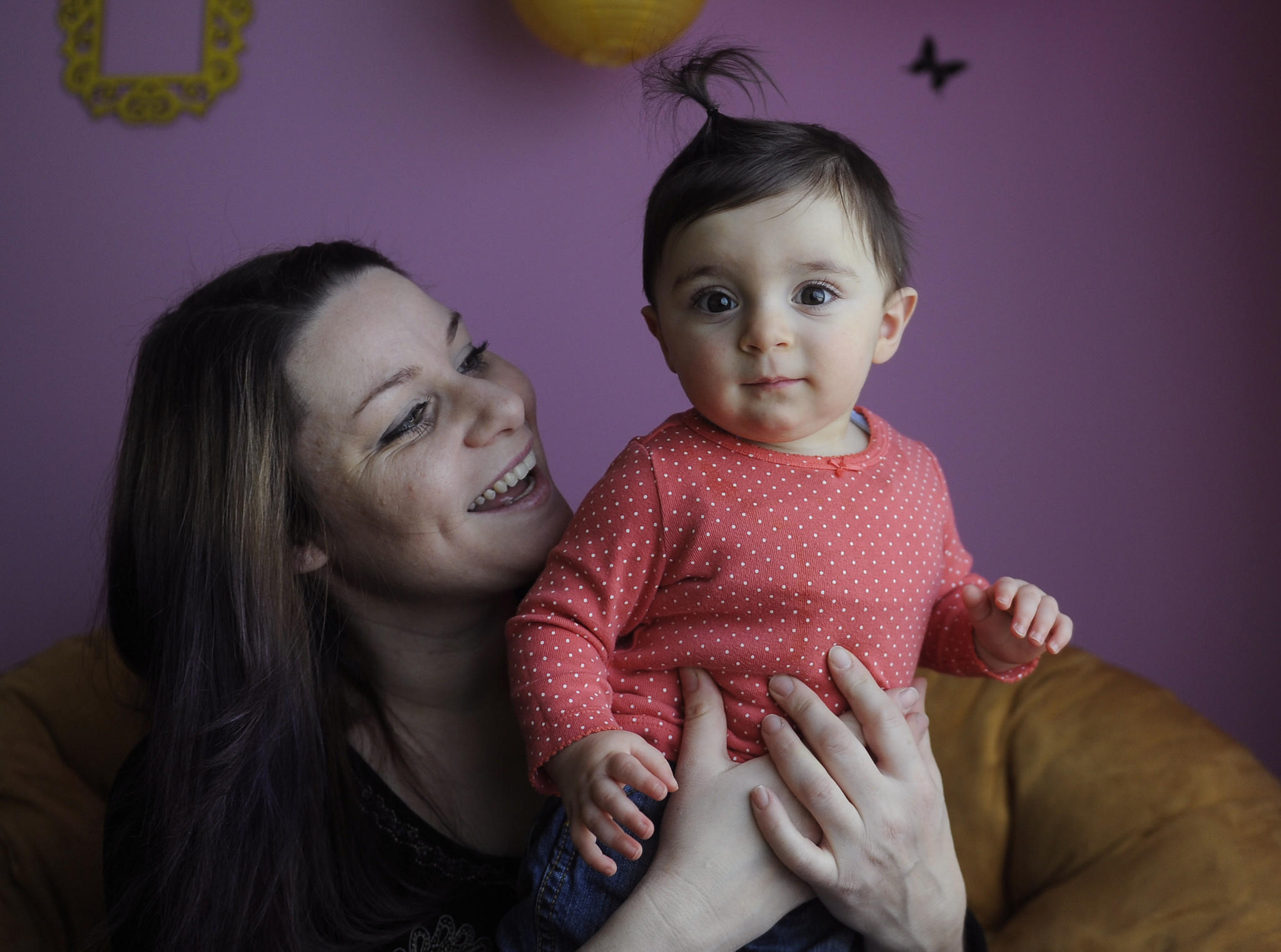 Christalene Karaiskakis holds her 10-month-old daughter, Anastasia, at their home. Karaiskakis had her placenta encapsulated and then she ingested it in pill form.