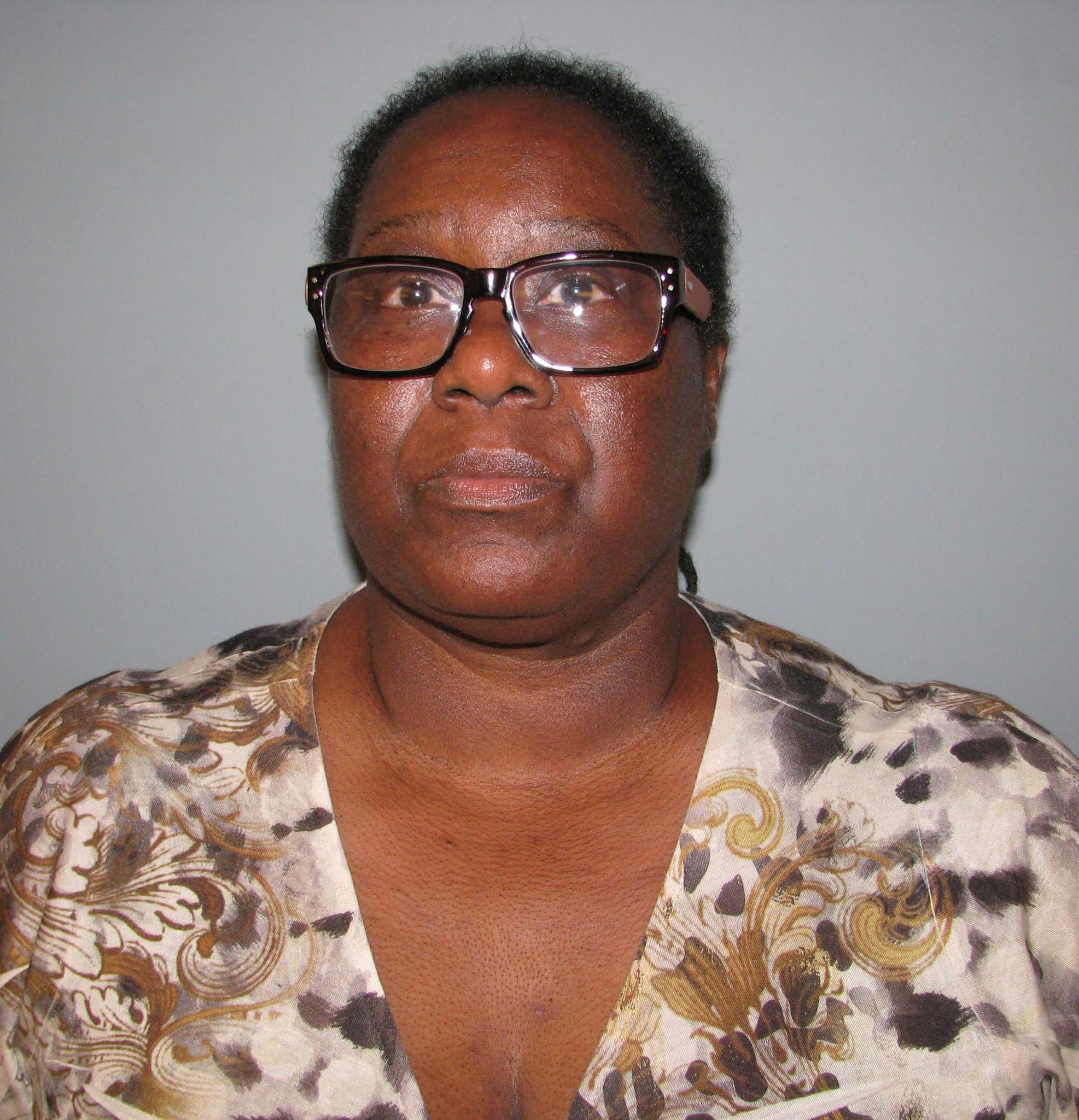 Karen O. Lewis, 57, was charged with first-degree larceny.
