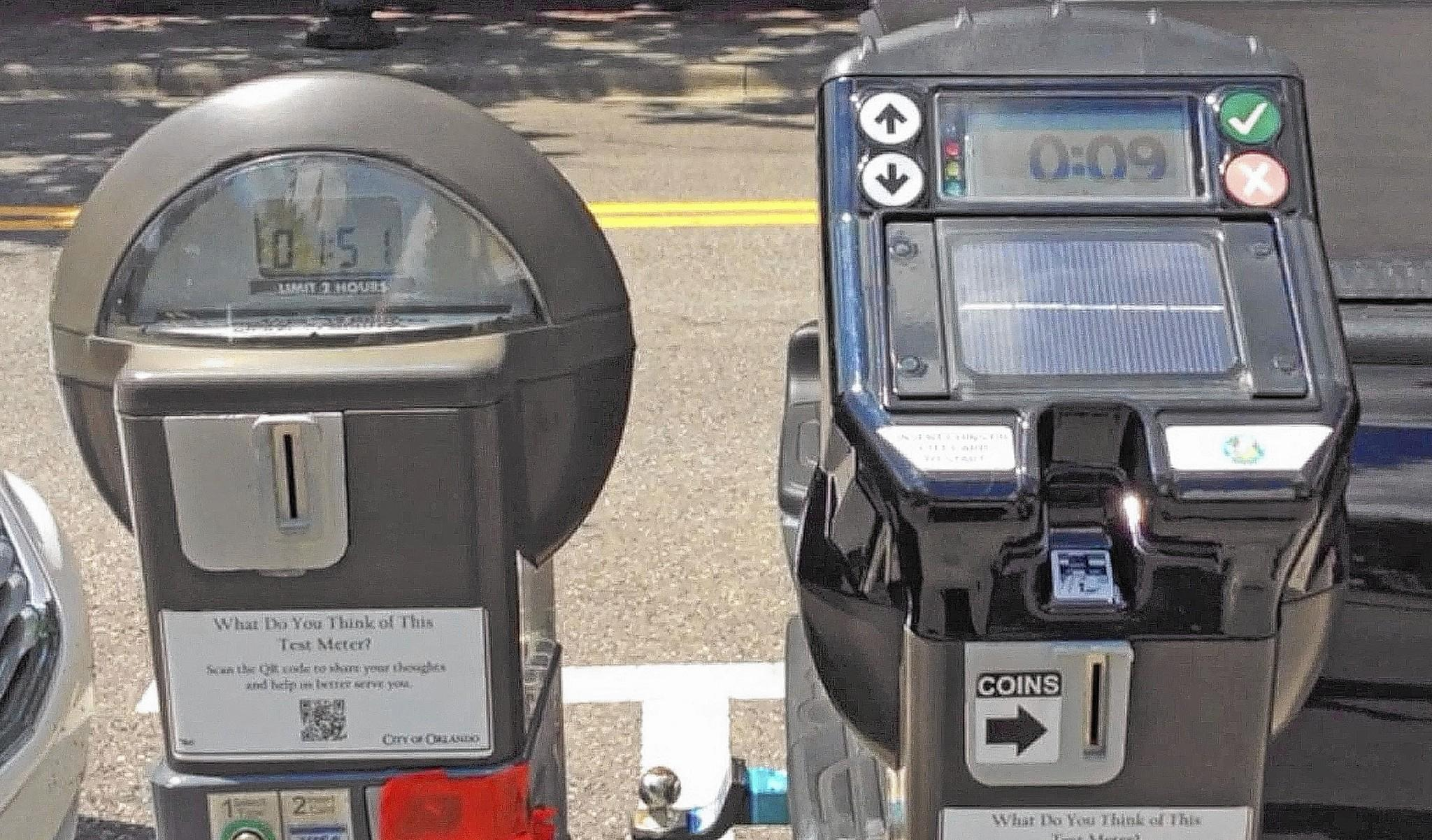 "New ""smart"" parking meters, right, are being tested on Central Boulevard in downtown Orlando."