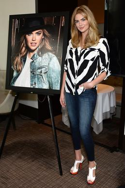 The model, who signed with fast-fashion brand Express in 2014, poses with her campaign poster at the Express and Kate Upton campaign launch event in New York on July 8.