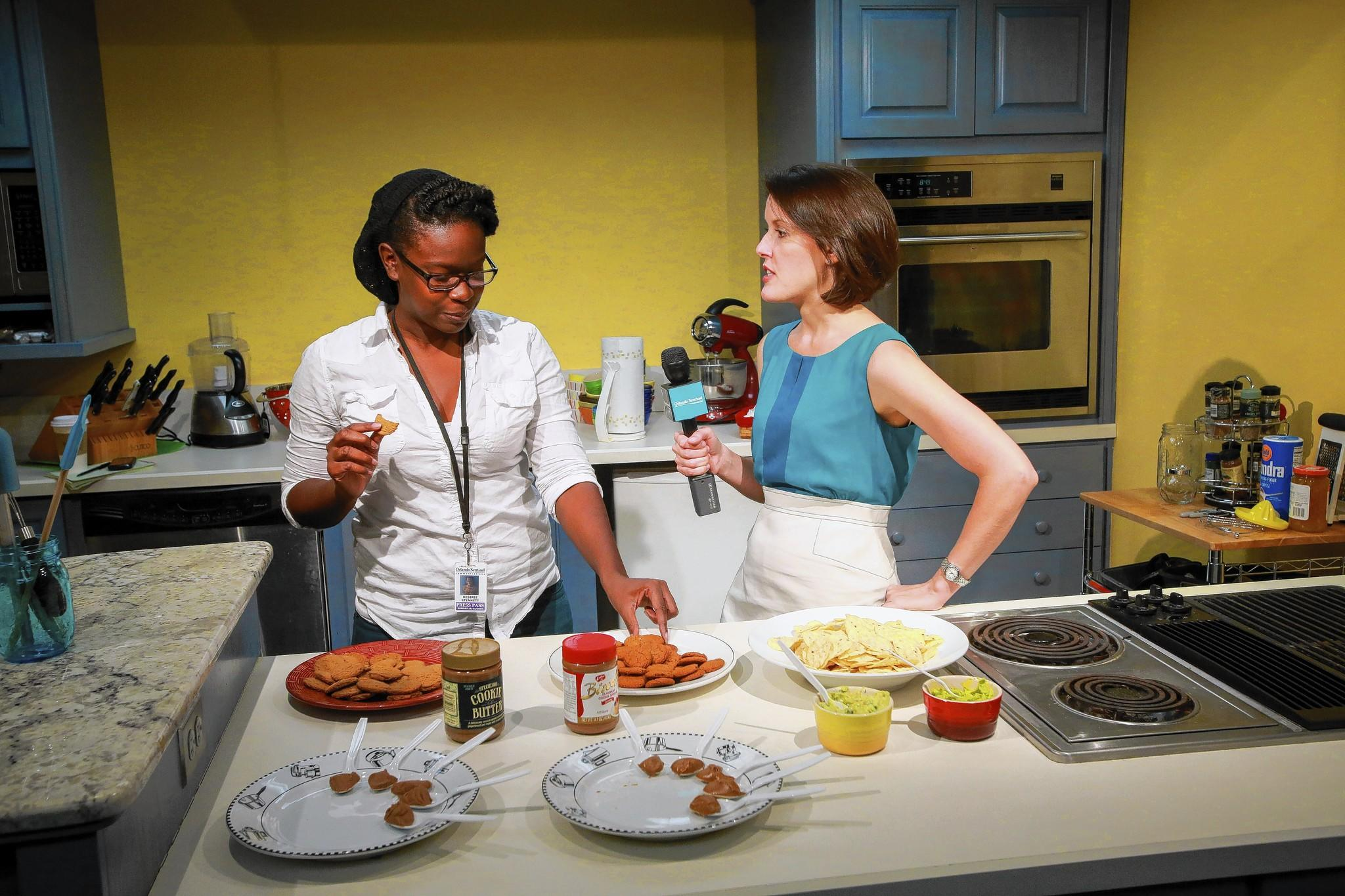 Orlando Sentinel reporter Desiree Stennett, left, and columnist Beth Kassab compare guacamole, ginger snaps and cookie butter from Trader Joe's and Publix in the Sentinel's test kitchen.