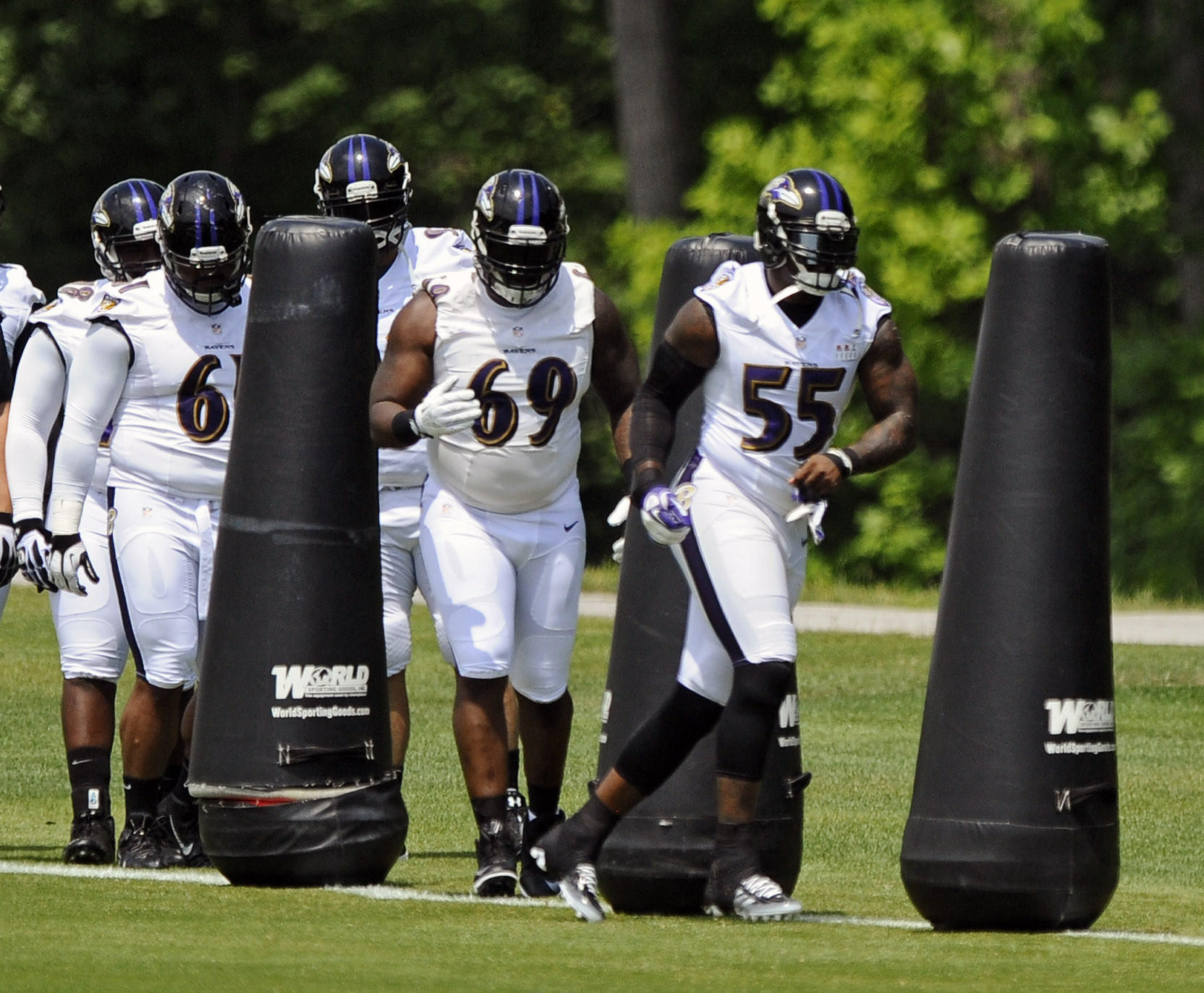 Ravens linebacker Terrell Suggs takes part in minicamp in June.