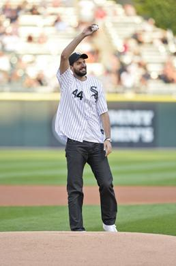 Nikola Mirotic waves to the fans before throwing out a ceremonial first pitch before the White Sox game against the Astros at U.S. Cellular Field.